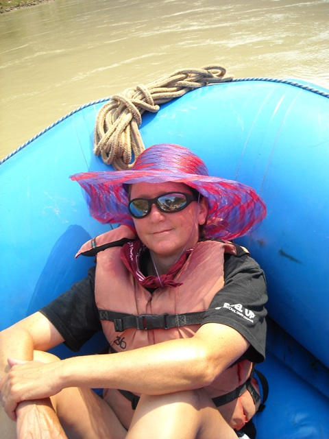 Julie relaxing while rafting the Grand Canyon-web